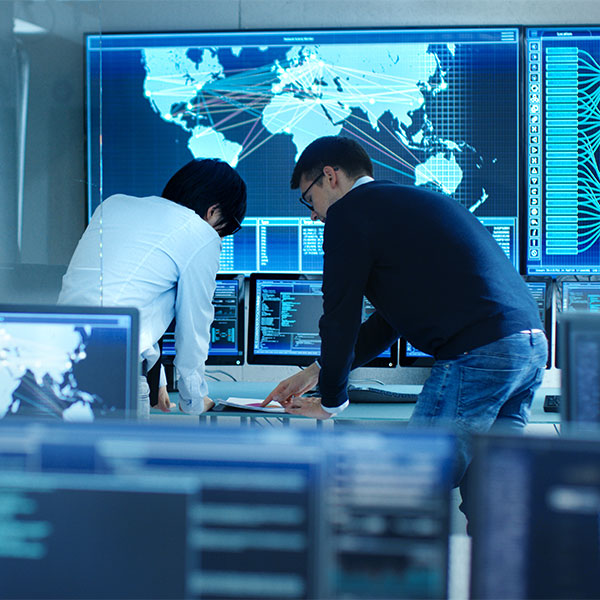 Two people working in a data center